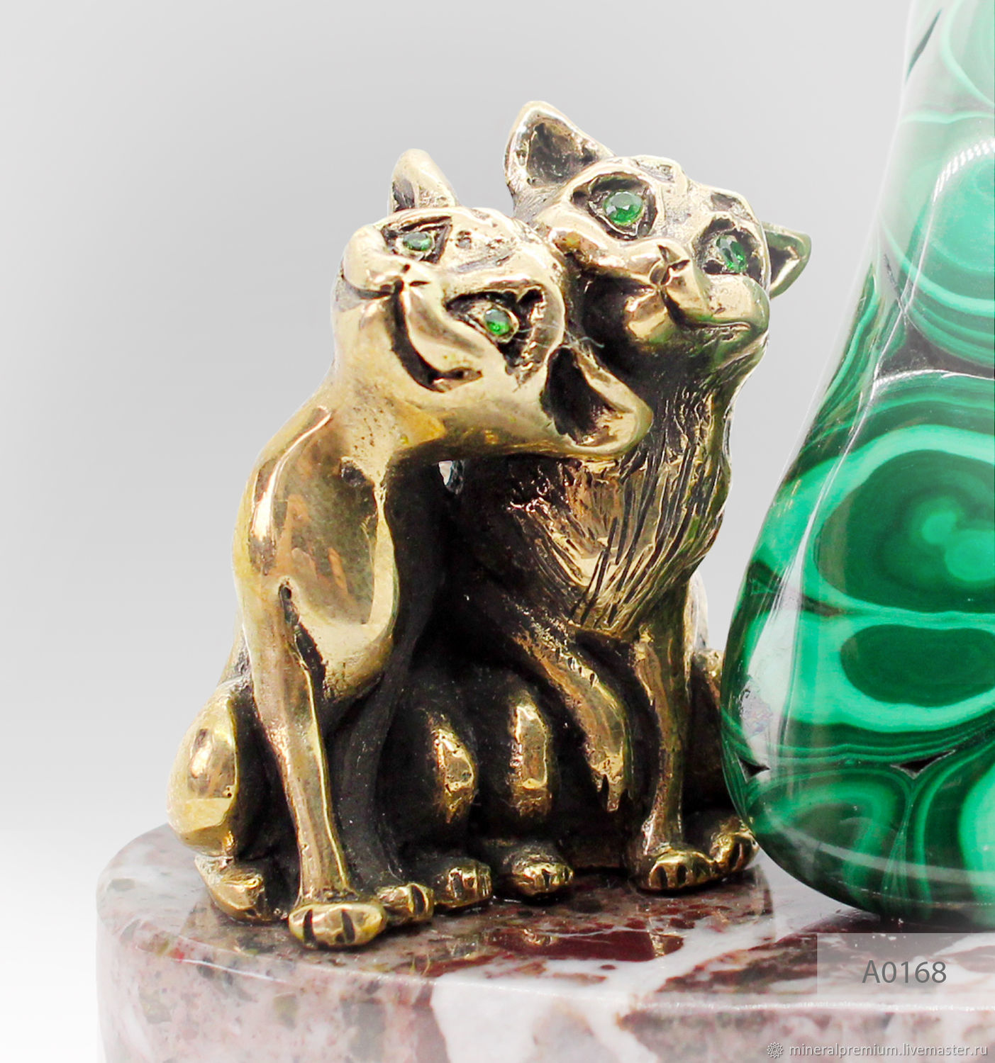 Cat — attracting good luck and harmony in the house, symbolize bravery, liberty, love and tenderness. Malachite – the