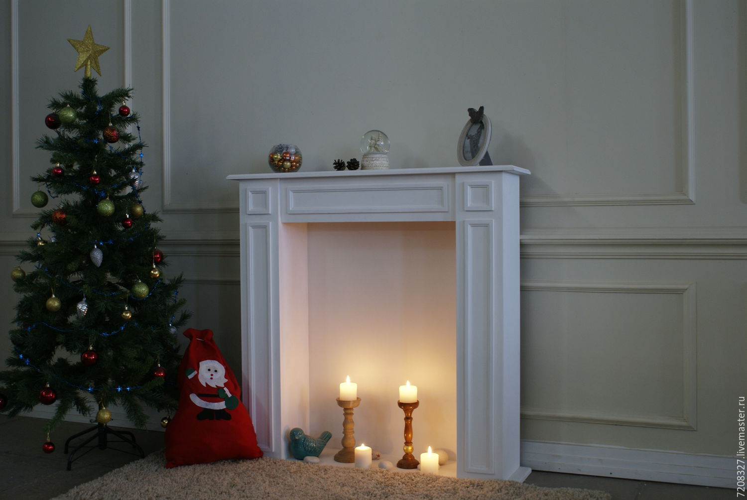 White decorative fireplace create a cozy Christmas and new year holidays. Due to the fact that the fireplace may high setting it low and candles the use of lighted under the supervision of a