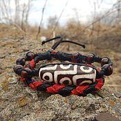 Украшения handmade. Livemaster - original item Braided leather bracelet with a large bead Dzi. Handmade.