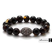 Украшения handmade. Livemaster - original item Women`s bracelet made of Baltic amber with silver charm. Handmade.