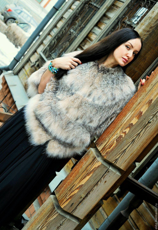 Курточка `Летучая мышь` из меха канадской рыси.Прорезные карманы.Имеется пристёгивающийся капюшон.Свободный покрой  и спущенный рукав типа пончо даёт удобство в носке.