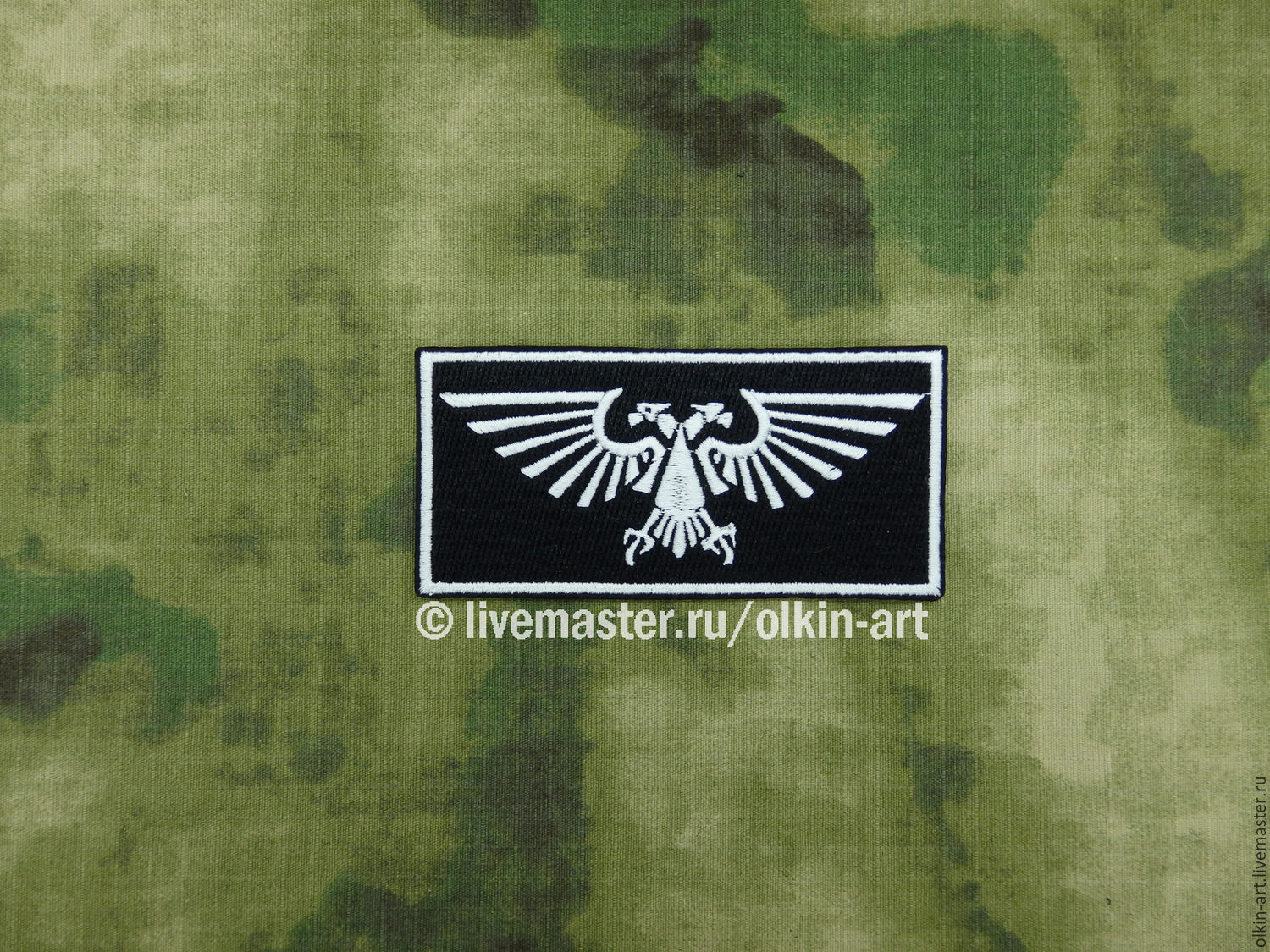 L'aquila is a small patch (rectangle) from Warhammer 40,000 Machine embroidery. Beloretskiy stripe. Patch. Chevron. Patch. Embroidery. Chevrons. Patches. Stripe. Buy patch.
