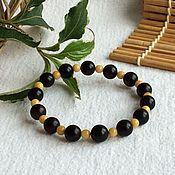 handmade. Livemaster - original item Bracelets of Baltic amber, color is cherry unpolished. Handmade.