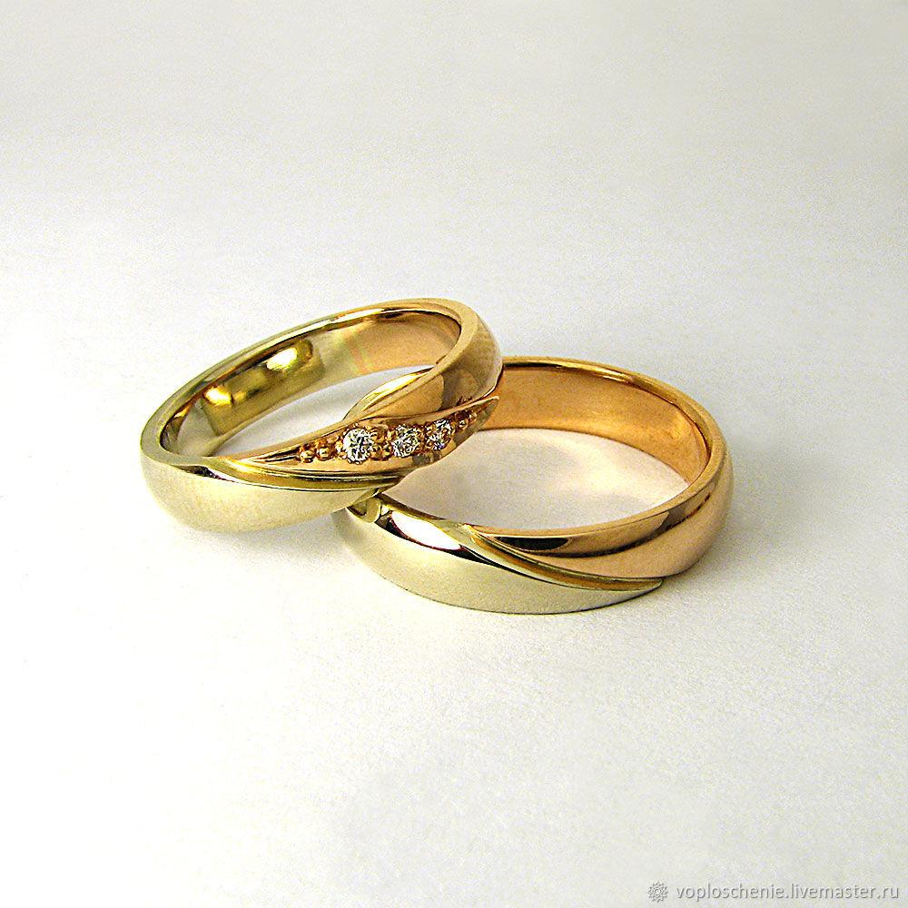 Обручальные кольца из комбинированного  золота 585 пробы с бриллиантом от Ювелирной дизайн-студии Воплощение Артикул: 01.1239