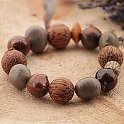Bead bracelet handmade. Livemaster - original item Bracelet ceramic beads made of wood and seeds in shades of brown. Handmade.