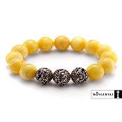 Сувениры и подарки handmade. Livemaster - original item Women`s, men`s bracelet made of Baltic amber with silver charms. Handmade.