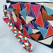 Сумки и аксессуары handmade. Livemaster - original item Clutch bag made of textile with applique leather