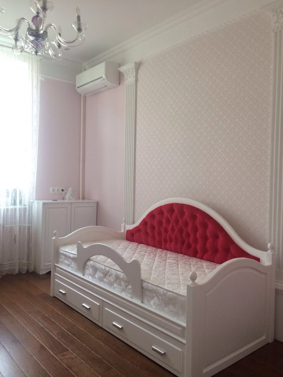 Cozy children's bed with upholstered headboard. Has a removable fence for child safety. At the bottom of the bed there are two roll-out drawers for storage. The difference in color,size, materials is