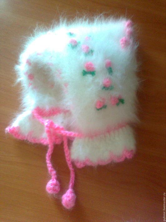 Шапочка для девочки .Связана из пуха кролика.Зимняя .теплая,толстенькая,плотная украшена цветочком розовым