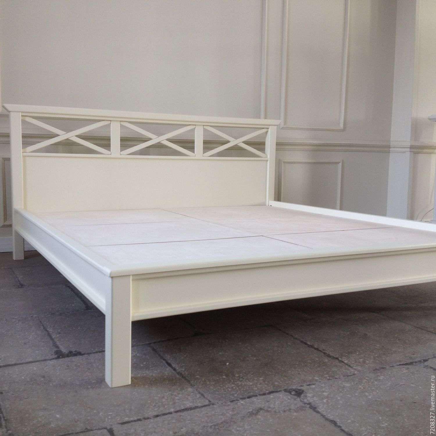 Wooden bed made of solid beech wood with a beautiful crossover elements at the head. The difference in color, size, materials is possible, due to manual work.
