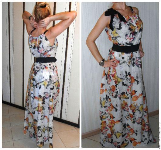 Платье из восхитительного невесомого батиста 100% хлопок. Необычный фруктовый принт, апельсины-бабочки, будут радовать вас все лето. Лиф на кулиске, за счет чего можно регулировать размер и положение