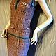 Вязаный ажурный бежевый костюм-двойка из топа и  прямой юбки  из хлопка предлагается как самостоятельная покупка, так и по отдельности.