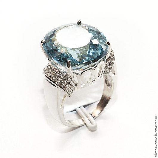 Кольцо с голубым  топазом 16,9 ct , серебро 925