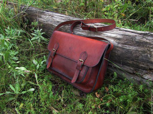 Стильный и практичный портфель в винтажном стиле.