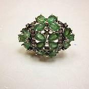Кольцо серебряное с изумрудами.