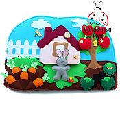 Куклы и игрушки ручной работы. Ярмарка Мастеров - ручная работа Развивающая игрушка из фетра с липучками, кнопками и кармашками. Handmade.