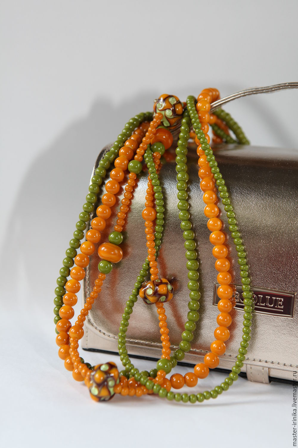 Beads multilayered tale in Forest green and terracotta colours  Iranica. Workshop images by Irina N.  Jewelry crafted  Photo made by the author of the work.