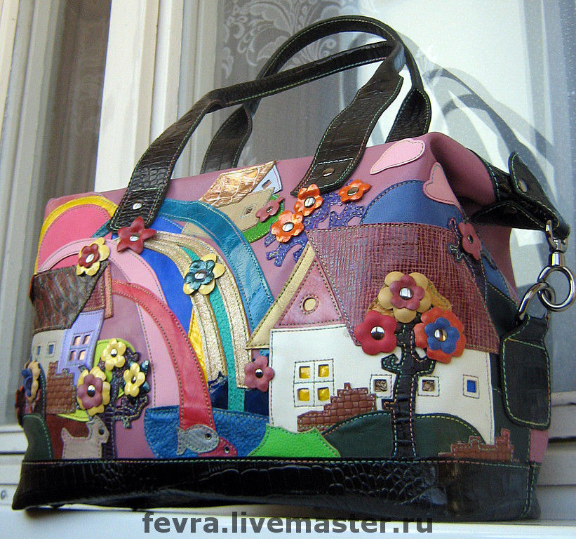 A bright and unusual bag. Rainbow raining on the city.