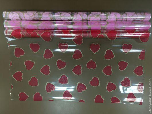 Пленка `Валентинки` ширина 60см в рулоне 450г - 200р красный, розовый, ярко-розовый.