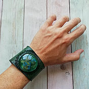 Украшения handmade. Livemaster - original item Green leather bracelet with embossed and epoxy cabochon. Handmade.