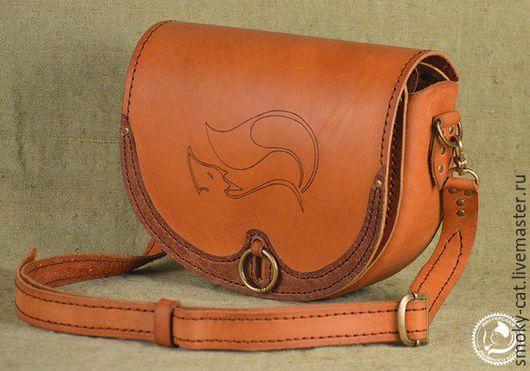 Женская лисья сумка из кожи.