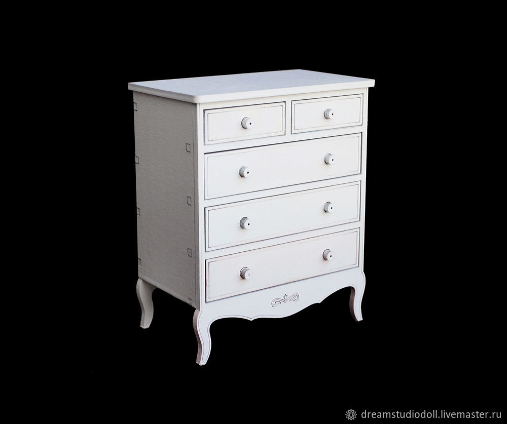 A chest of drawers for dolls.