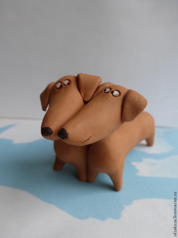 Собачка из глины