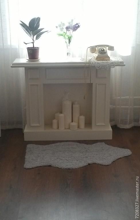 Белый декоративный камин, красивый и функциональный. Декорирование свечами и предметами интерьера придаст теплоту и уют Вашему дому.