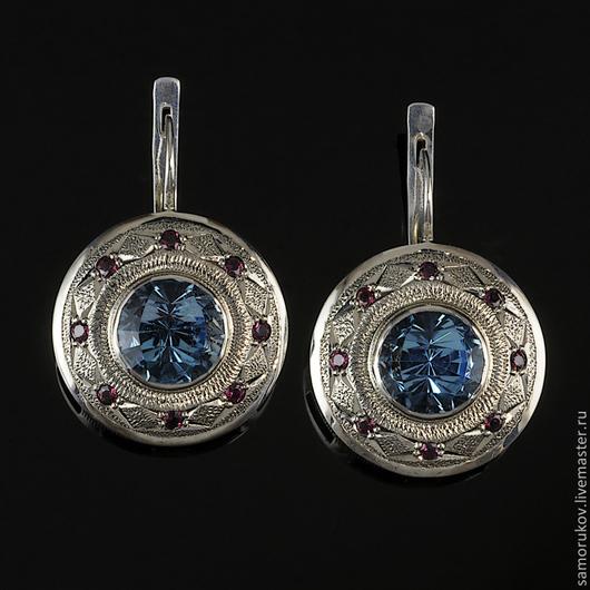 Серебро 925 пробы, синие топазы цвета - London blue topaz, родолиты. Вес каждой серьги около 8 грамм