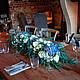Оформление цветами свадебного стола в ресторане Les Artists
