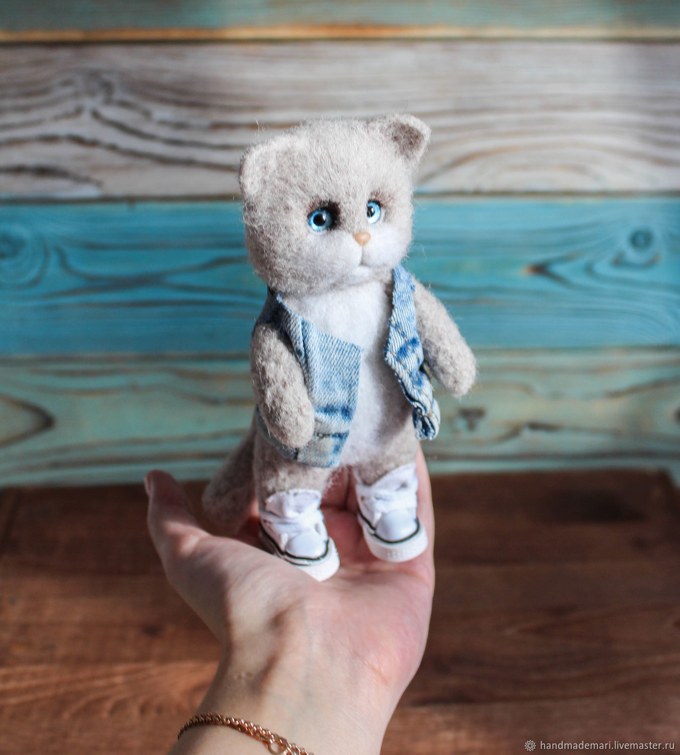 Cat in sneakers and jeans toy made of
