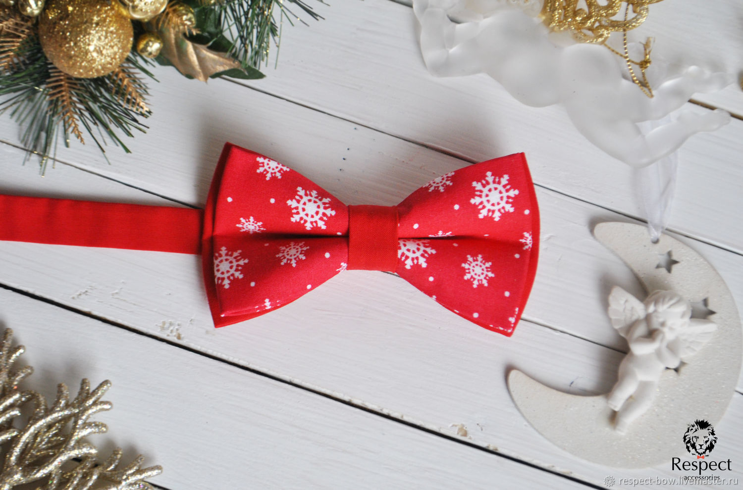 red bow tie with christmas picture snowflakes on a scarlet red cloth