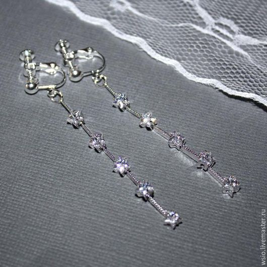 Украшения на уши для женщин и девушек. Длинные клипсы с миниатюрными,сияющими звёздочками из кубического циркония.