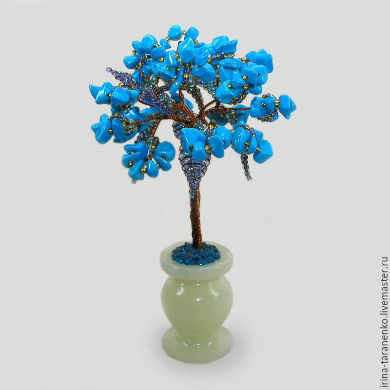 Miniature wood turquoise `happiness` in a vase of onyx