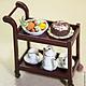 Торт `Шоколадный трюфель` Миниатюра еды 1:12 на сервировочной столике.