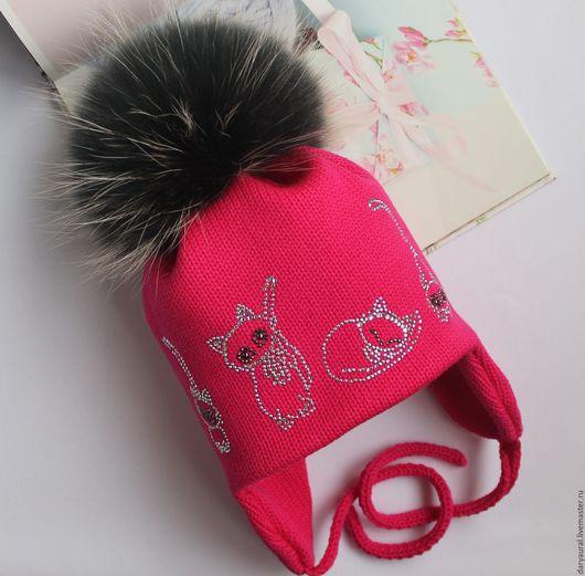 Милые создания на шапочке вызовут восторг у девочек.