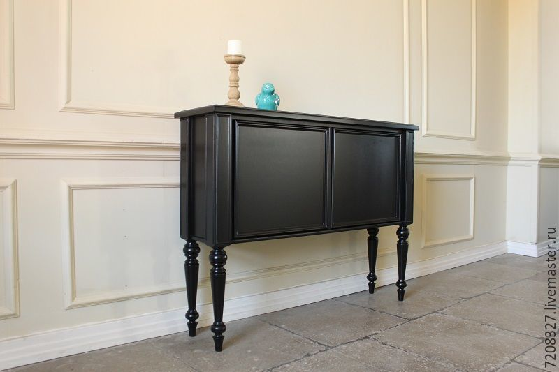 A high console on turned legs. in a classic style. Custom for use as a bar, wine storage.