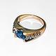 Кольцо золотое с лондон-топазом и голубыми сапфирами